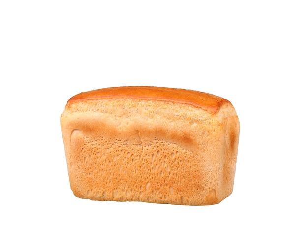 Bochenek białego chleba na białym tle na białej ścianie
