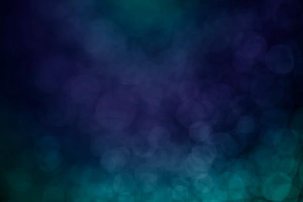 Bokeh kropki wody niebieski na tle