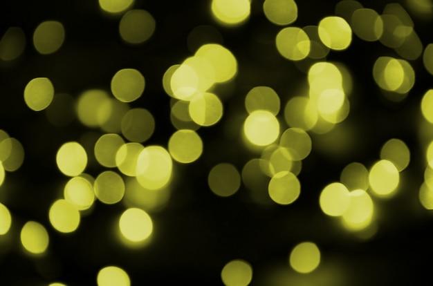 Bokeh skutka złoty żółty defocused lekki tło. koncepcja światła bożego narodzenia