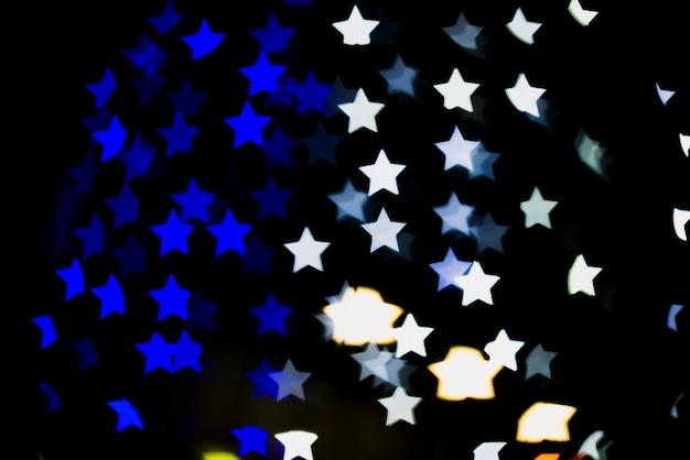 Bokeh tło z światłami w gwiazdowym kształcie
