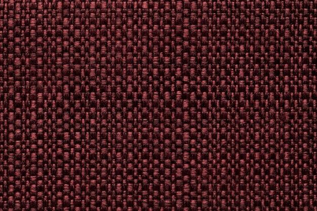 Bordowe tło tekstylne z szachownicą, struktura czerwonego materiału