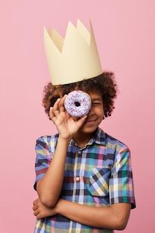 Boy holding donut
