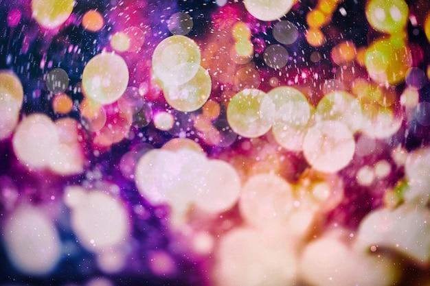 Boże narodzenie bokeh świecące tło. świecące wakacje streszczenie niewyraźne kolorowe tło. jasne żywe niewyraźne kolorowe święto nowego roku bokeh