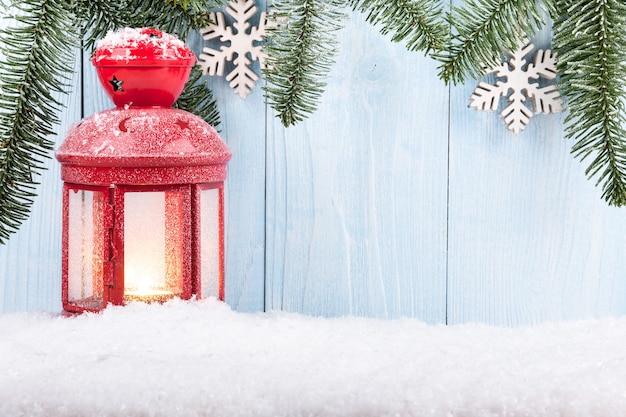 Boże narodzenie i nowy rok koncepcja tło z latarnią świeca bożonarodzeniowa