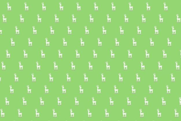 Boże narodzenie izometryczny wzór, tło, baner. minimalna kompozycja wykonana ze świątecznego białego renifera na zielonym tle. widok z góry. koncepcja wakacje nowy rok. prezenty świąteczne, gratulacje