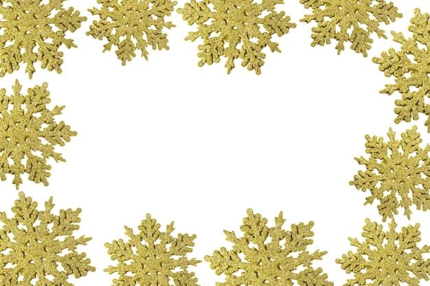 Boże Narodzenie Rama Ze Złotymi Płatkami śniegu. Obramowanie Konfetti Cekinów. Brokat W Proszku Musujące Tło. Premium Zdjęcia