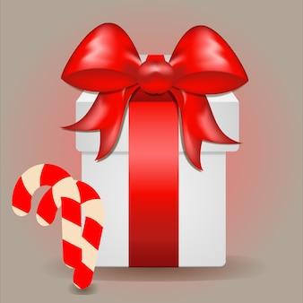 Boże narodzenie tło. świąteczny projekt realistycznego pudełka na prezenty i słodkiego lizaka. świąteczny plakat, kartki okolicznościowe, baner strony internetowej. płaski widok z góry. treść wakacji.
