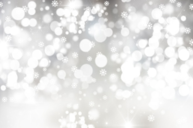 Boże narodzenie tło z płatki śniegu i światła bokeh