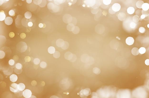Boże narodzenie złote abstrakcyjne tło z cząsteczkami i gwiazdami