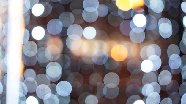 Boże narodzenie złote tło. złote wakacje świecące tło. nieostre tło z migającymi gwiazdami. zamazana kurtyna bokeh