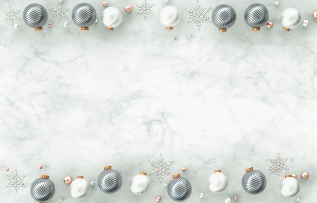 Bożenarodzeniowa 3d dekoraci granicy rama z bożenarodzeniową piłką, płatek śniegu na bielu marmuru kamienia tle. boże narodzenie, zima, nowy rok. leżał z płaskim, widok z góry, miejsce.