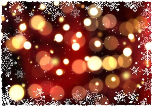Bożenarodzeniowy tło z płatkami śniegu i bokeh światłami
