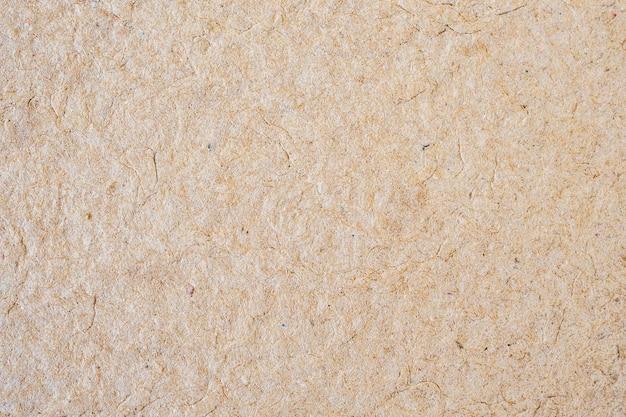 Brązowa ściana tekstury papieru z recyklingu