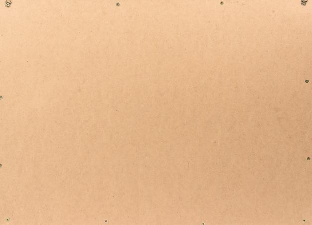 Brązowa sklejka ze śrubami, pełna klatka, abstrakcyjne tło