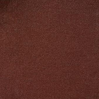 Brązowa tekstura papieru ściernego na tle papieru.