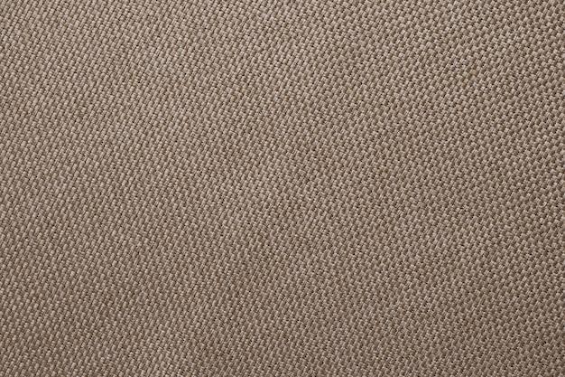 Brązowa tekstura wory. powierzchnia tkaniny lnianej.