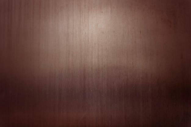 Brązowe cienkie tło z teksturą metalu