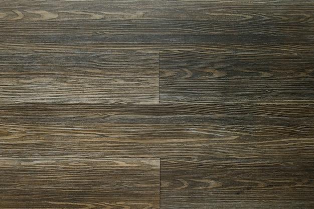 Brązowe drewniane płytki teksturowane w tle