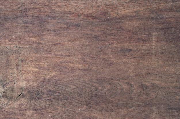 Brązowe drewno płyta tło i tekstura.