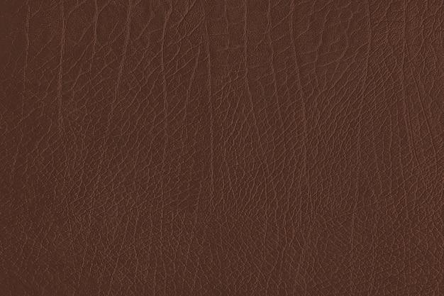 Brązowe pogniecione skórzane teksturowane tło