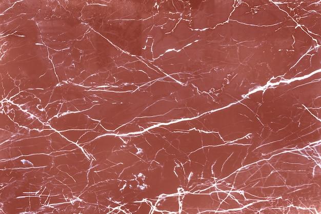 Brązowe porysowane marmurowe teksturowane tło