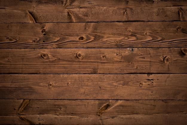 Brązowe stare drewniane ściany z poziomymi deskami, rustykalne deski tekstury