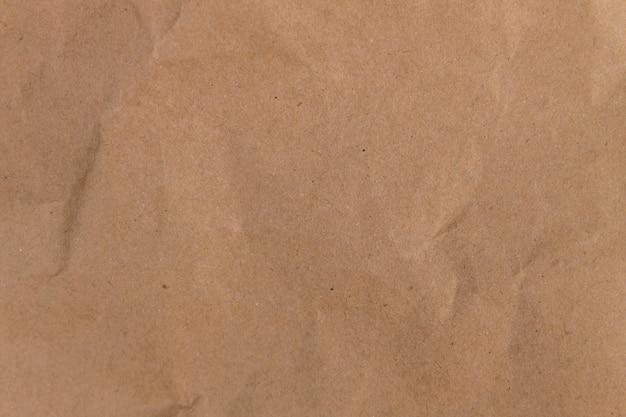 Brązowe tło papieru ekologicznego. tekstura papieru z recyklingu