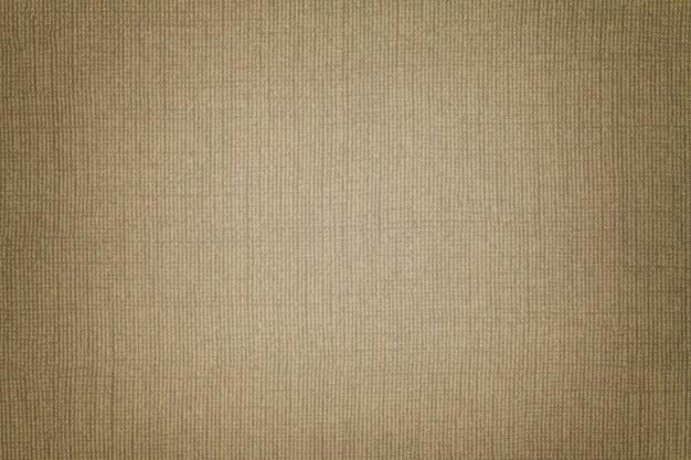 Brązowe tło z materiału tekstylnego z wiklinowym wzorem