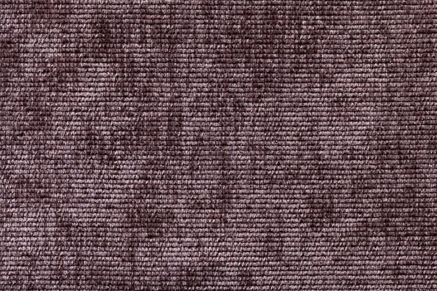 Brązowe tło z miękkiego materiału tekstylnego.