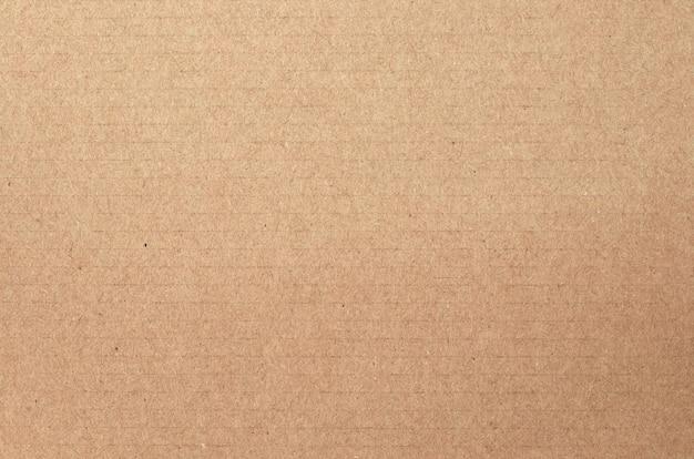 Brązowy arkusz tektury, tekstura pudełka z papieru do recyklingu.
