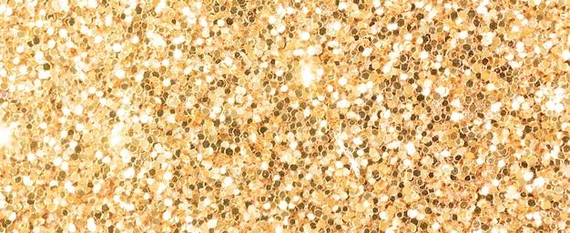Brązowy brokat tekstury, zdjęcie makro transparent, powierzchnia o wysokiej szczegółowości. zbliżenie na papier ścierny, abstrakcyjne światła brokatowe na obchody świąt, nowy rok i boże narodzenie. zdjęcie koncepcji efektu świecącego