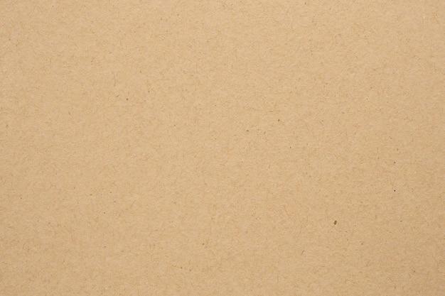 Brązowy eko makulaturowy papier pakowy arkusz tekstury tło kartonowe