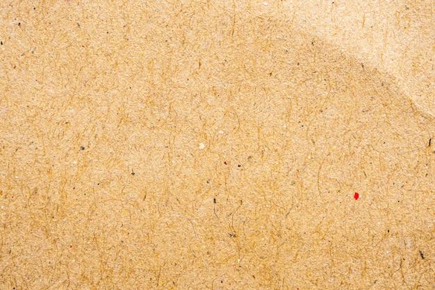 Brązowy eko makulaturowy papier pakowy tekstura tło kartonowe