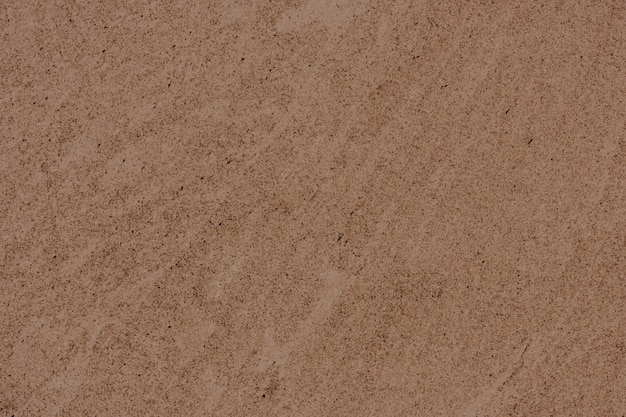 Brązowy gładki betonowy mur w tle