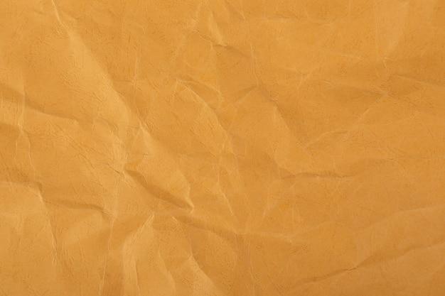 Brązowy lub żółty zmarszczka recyklingu tło papieru.