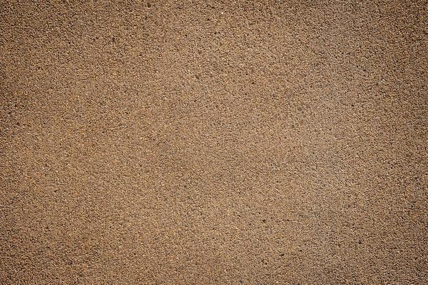 Brązowy mały kamyk kamienna podłoga tekstura tło.