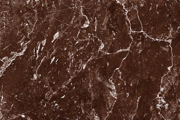 Brązowy marmurowy wzór tła z teksturą