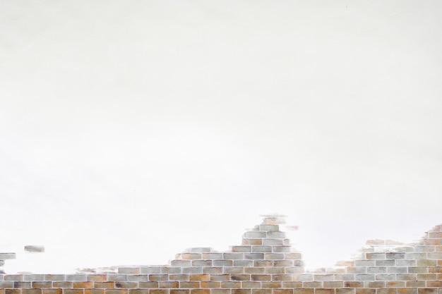 Brązowy mur z cegły teksturowane tło