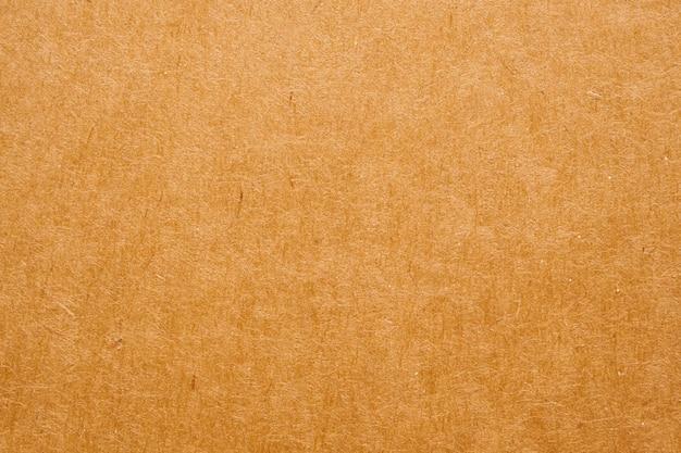 Brązowy papier eko recyklingowany papier pakowy tekstura tło kartonowe