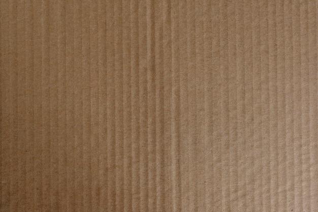 Brązowy papier falisty teksturowany w tle