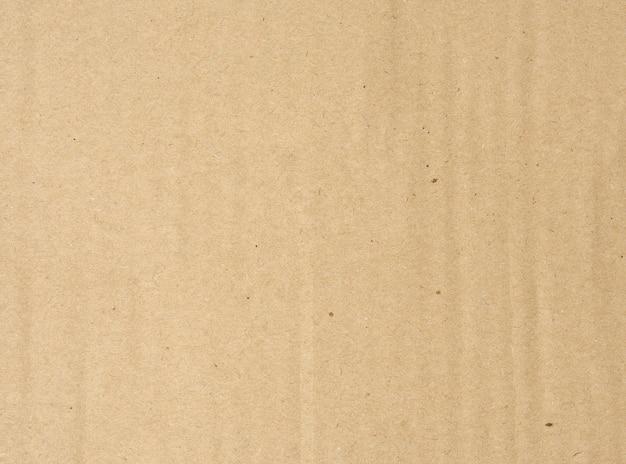 Brązowy papier falisty tekstury, pełna klatka, z bliska