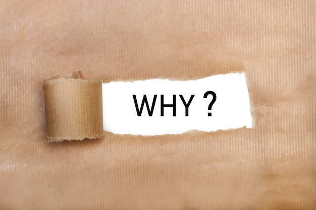 """Brązowy papier łzowy z napisem """"dlaczego"""""""