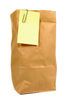 Brązowy papierowa torba obiad z żółtym ją zaksięgować uwaga