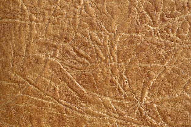 Brązowy skórzany teksturowanej tło