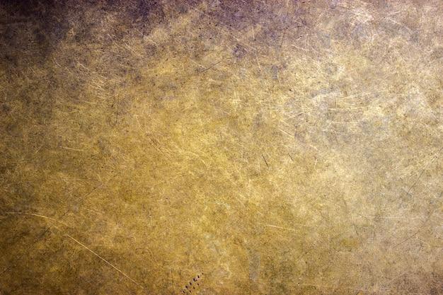 Brązowy talerz tekstury złote metalowe tło dla projektu