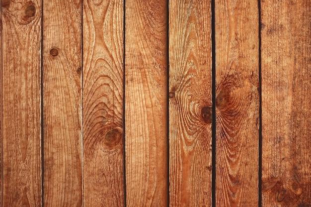 Brązowy tekstury drewna deski. stare odrapane deski. drewniane ściany w tle