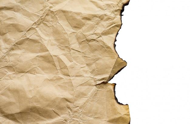 Brązowy vintage spalił papier, pojedyncze szczegóły, duże tło, tekstura