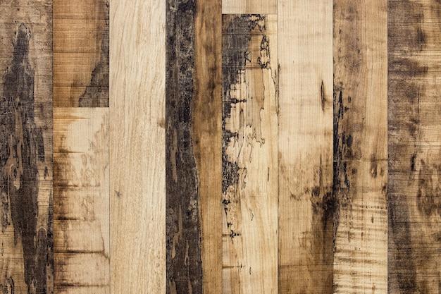 Brązowy wzór tekstury w paski drewnianej deski na tle