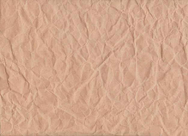 Brązowy zmięty papier tło