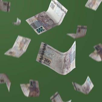 Brazylijskie pieniądze 200 realisowe banknoty spadające na zielone tło